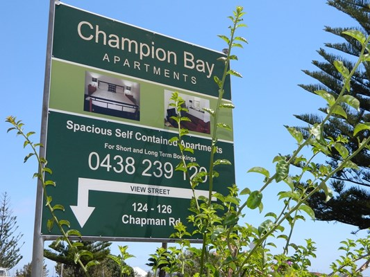 Champion Bay Apartments - Entry sign on Chapman Rd